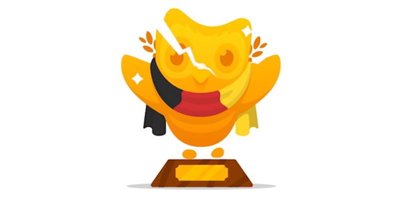 A duolingo golden owl trophy with a crack. Duolingo isn't perfect, but it isn't terrible either.